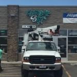 smoke spot business sign installation